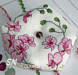 Faby Reilly Designs Plum Orchid Biscornu - click to see more
