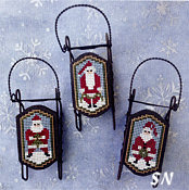 Foxwood Crossings Santa Folk Sleds - click to see more