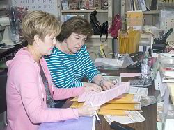 Betty and Susan are intent on something... looks like order questions - click for a larger view