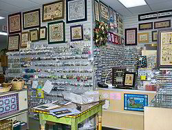 Amazingly stuffed walls of buttons, beads and treasures - click for a larger view