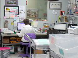 Jan at the postage computer - click for a larger view